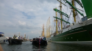 Tall ships in Amsterdam seen from a dinghy