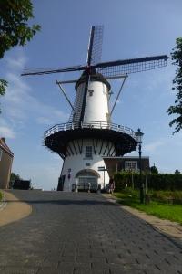 Beautiful windmill in Willemstadt. Picturesque little village.