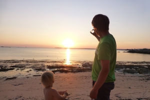 My two best friends plus a sandy beach and sunset outside Concarneau.